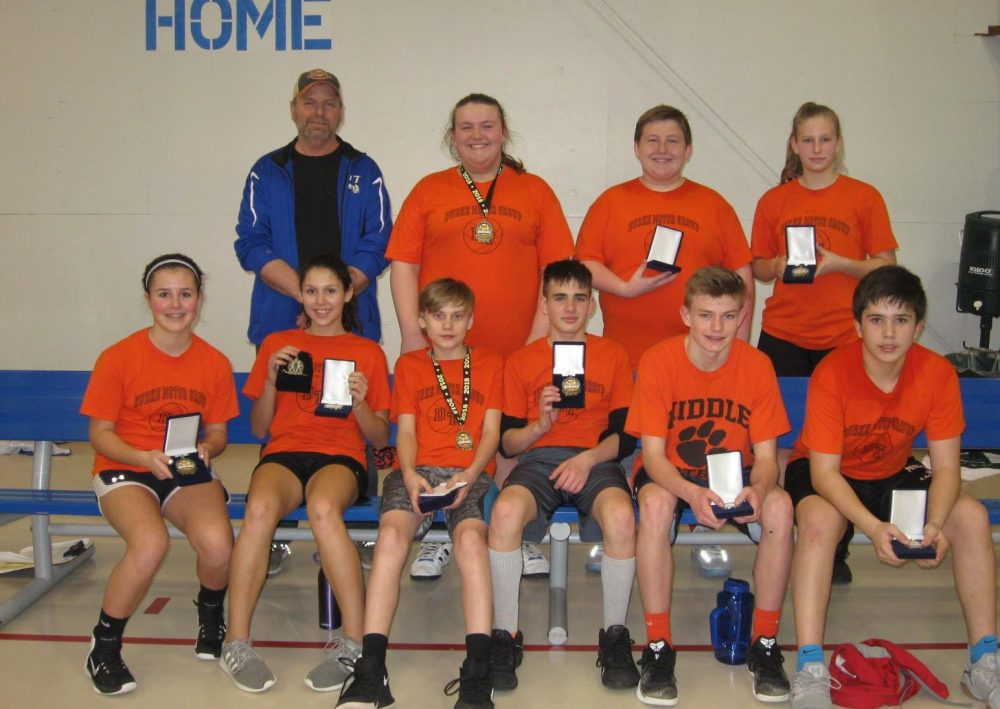 Basketball team showing off medals
